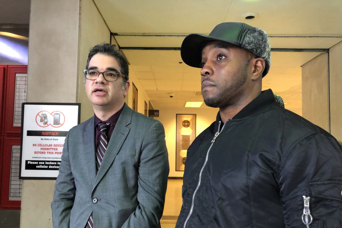 Attorney Joshua Tepfer talks to reporters Tuesday about Cook County prosecutors' decision to overturn the conviction of his client Demetrius Johnson.