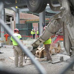 2:57 p.m. Concrete being poured into wheelbarrow on Waveland -
