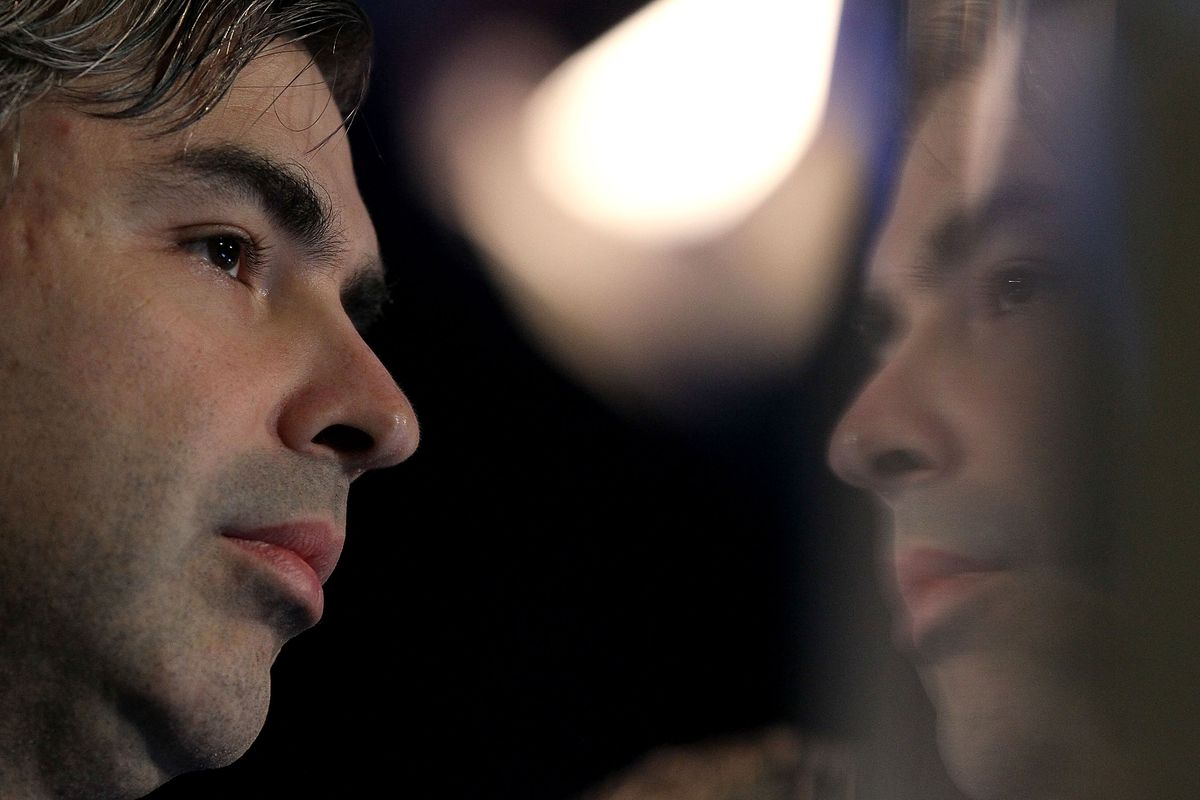A photograph of Larry Page, with a reflection.