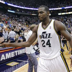 Utah Jazz forward Paul Millsap (24) gets a hand slap from Jazz General Manager kevin O'Connor after the jazz win over the Phoenix Suns play Tuesday, April 24, 2012 in Energy Solutions arena 100-88.