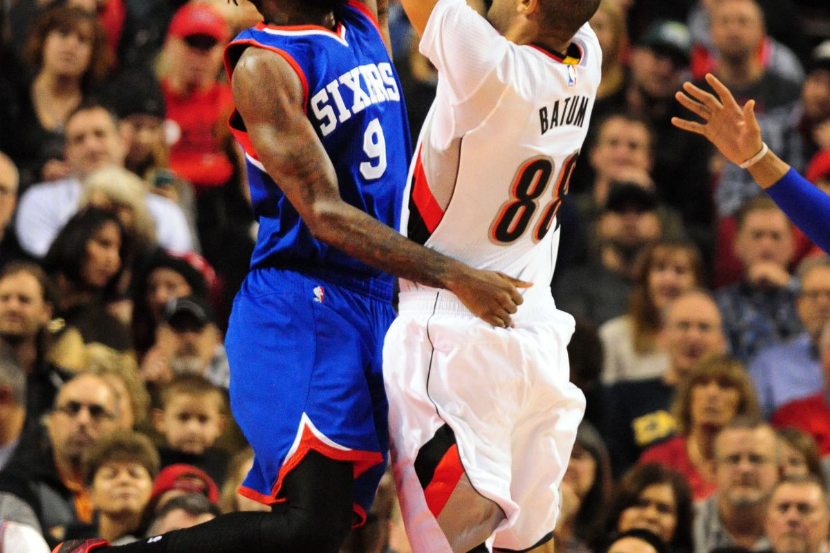 Nicolas Batum goes up for a shot over JaKarr Sampson of the 76ers