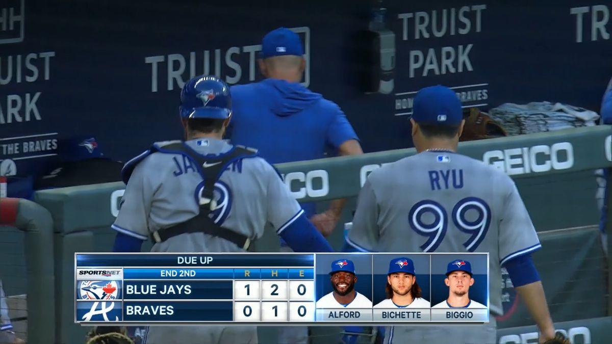 Catcher Danny Jansen wears #9, pitcher Hyun Jin Ryu wears #99.