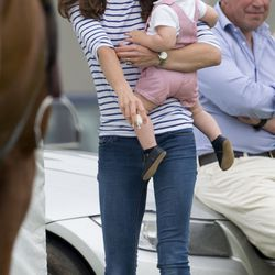 With Prince George on June 15th, 2014 in a Me + Em striped shirt, skinny jeans, and Sebago 'Bala' boat shoes.