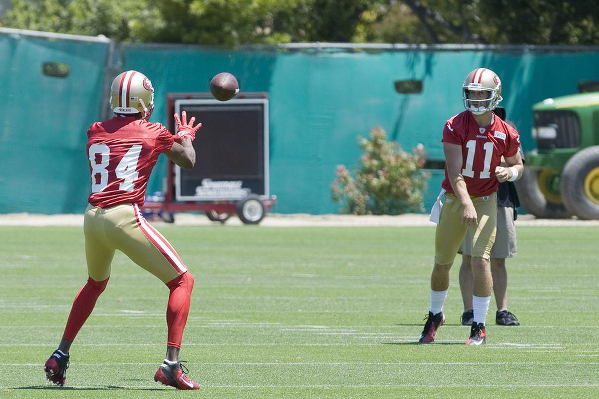 May 23, 2012; Santa Clara, CA, USA;  San Francisco 49ers wide receiver Randy Moss (84) catches a ball from quarterback Alex Smith (11) at the 49ers practice facility.  Mandatory Credit: Ed Szczepanski-US PRESSWIRE
