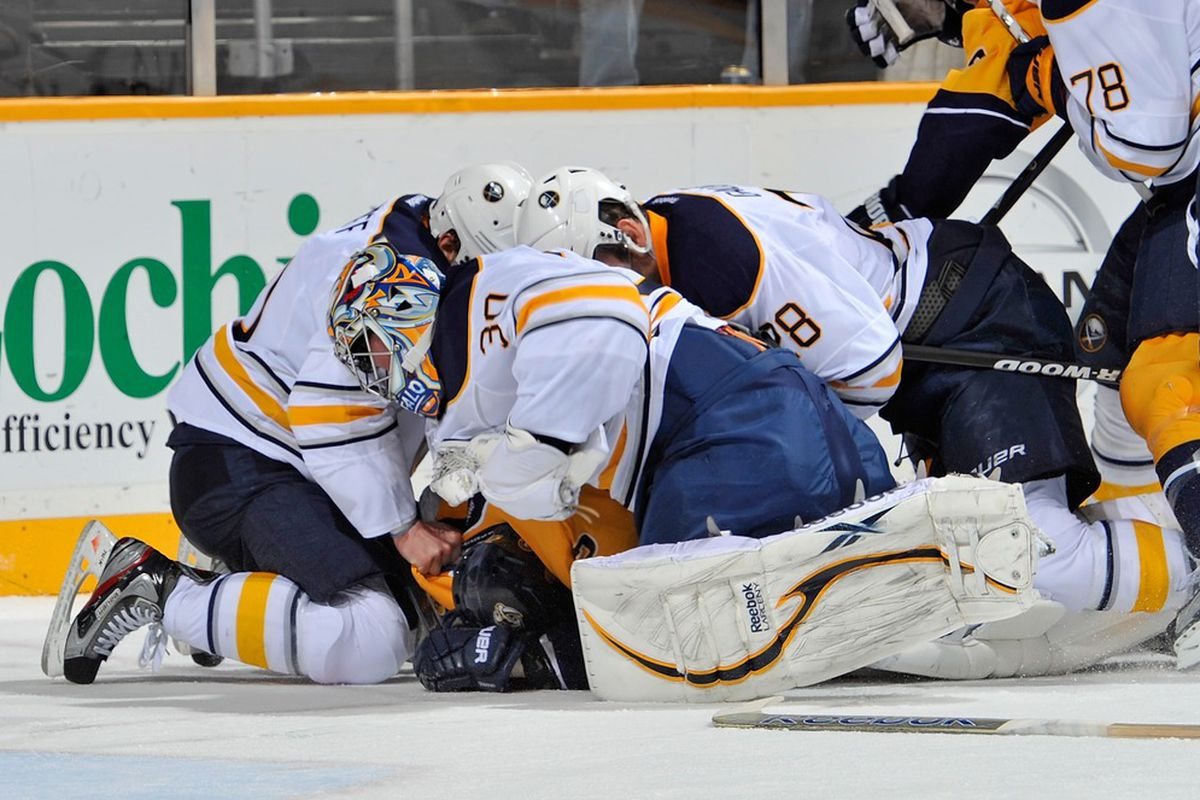 NASHVILLE, TN - DECEMBER 03: Goalie Ryan Miller #30 of the Buffalo Sabres punches Jordin Tootoo #22 of the Nashville Predators at the Bridgestone Arena on December 3, 2011 in Nashville, Tennessee.  (Photo by Frederick Breedon/Getty Images)