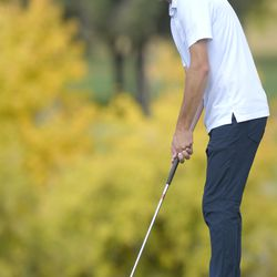 Ridgeline's Zach Skinner putts the ball on the seventh hole during the second round of the 4A boys state golf tournament on Thursday, Oct. 7, 2021, in Smithfield.