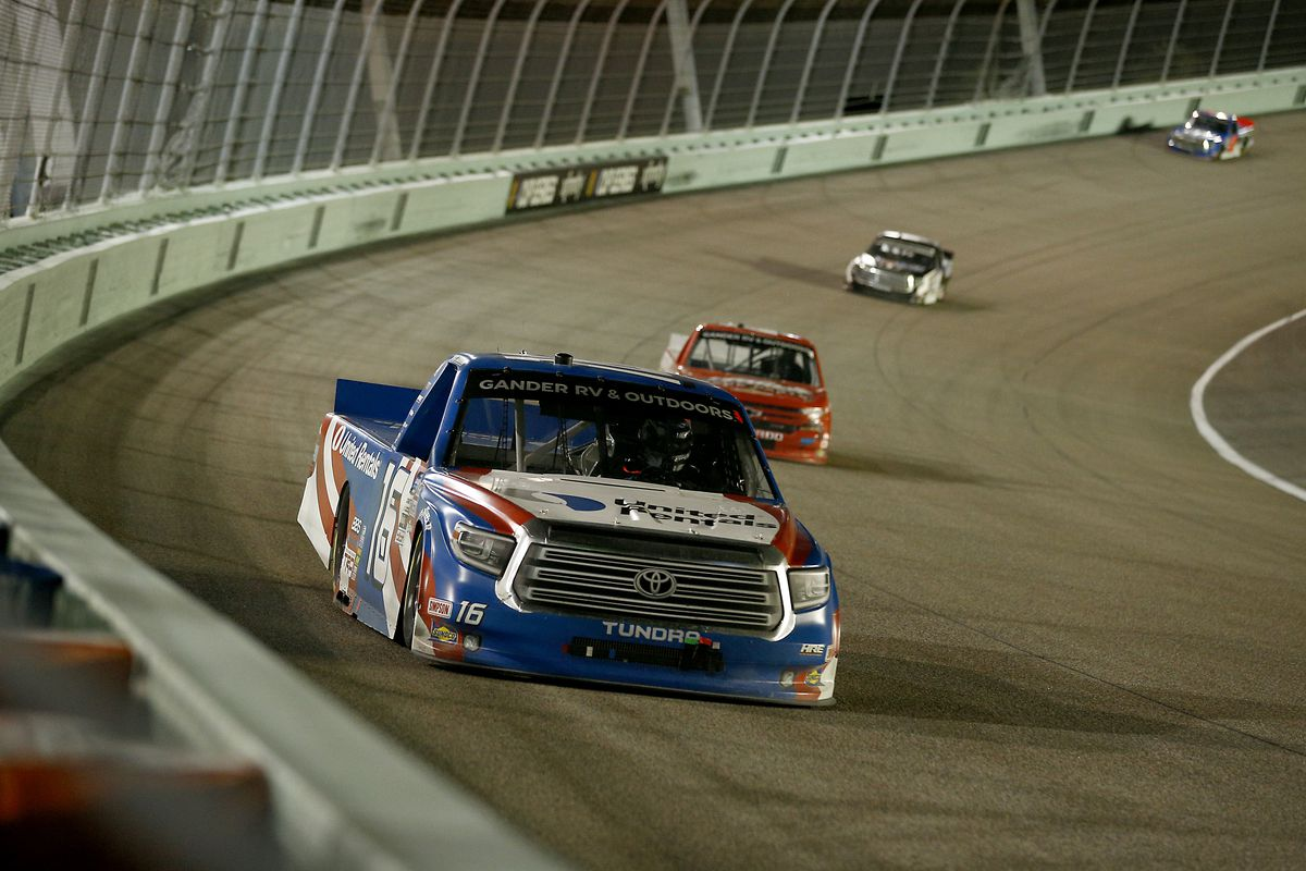 Austin Hill, driver of the #16 United Rentals Toyota, leads a pack of trucks during the NASCAR Gander RV & Outdoors Truck Series Baptist Health 200 at Homestead-Miami Speedway on