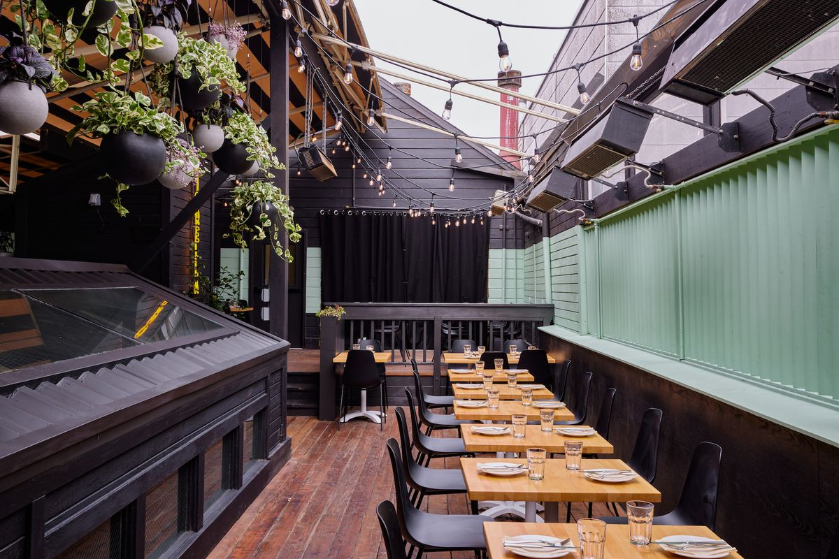 The rooftop deck at Fiorella Sunset dressed up with string lights and a retractable awning