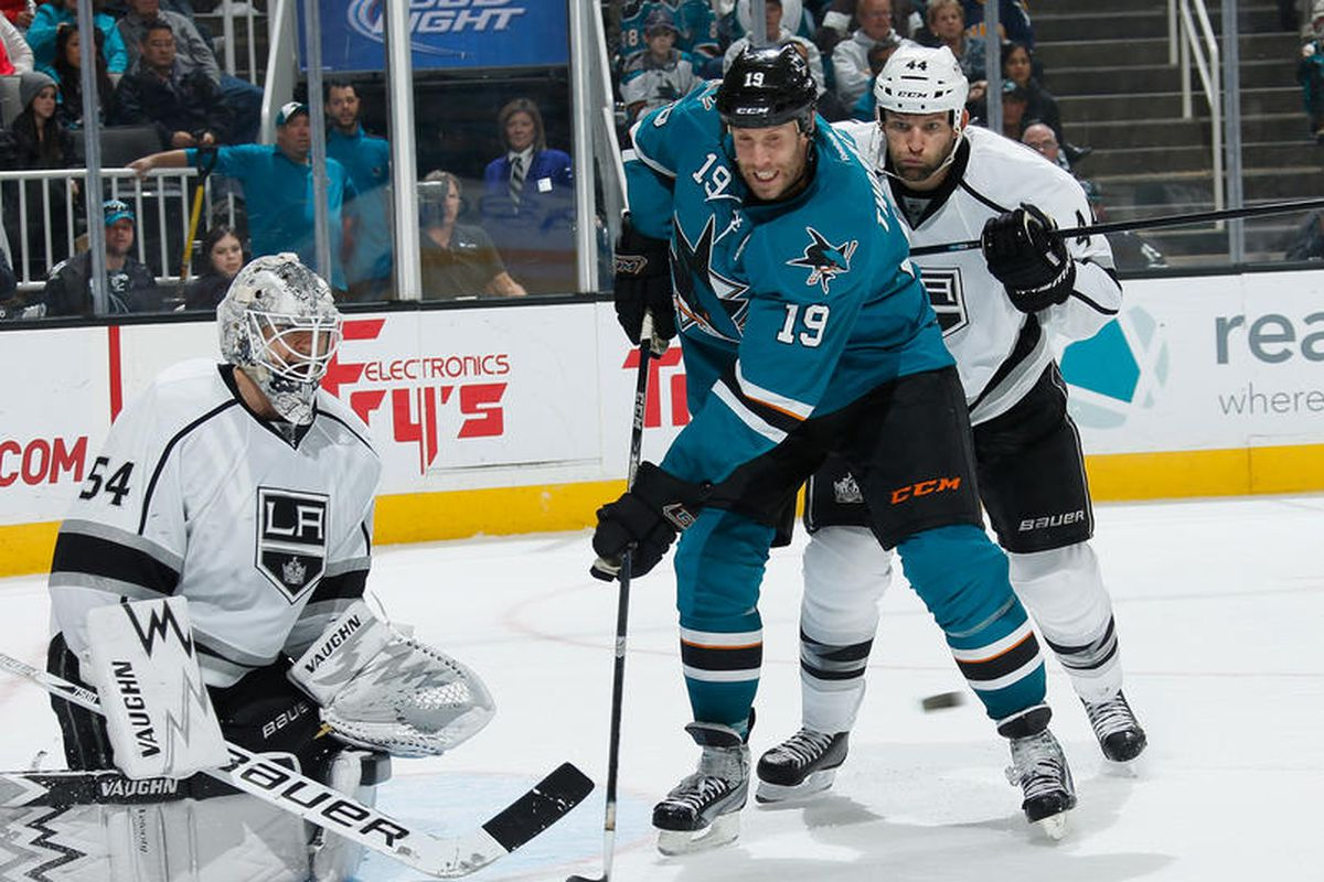 Robyn Regehr attempts to distract Joe Thornton by making fart noises in his ear.