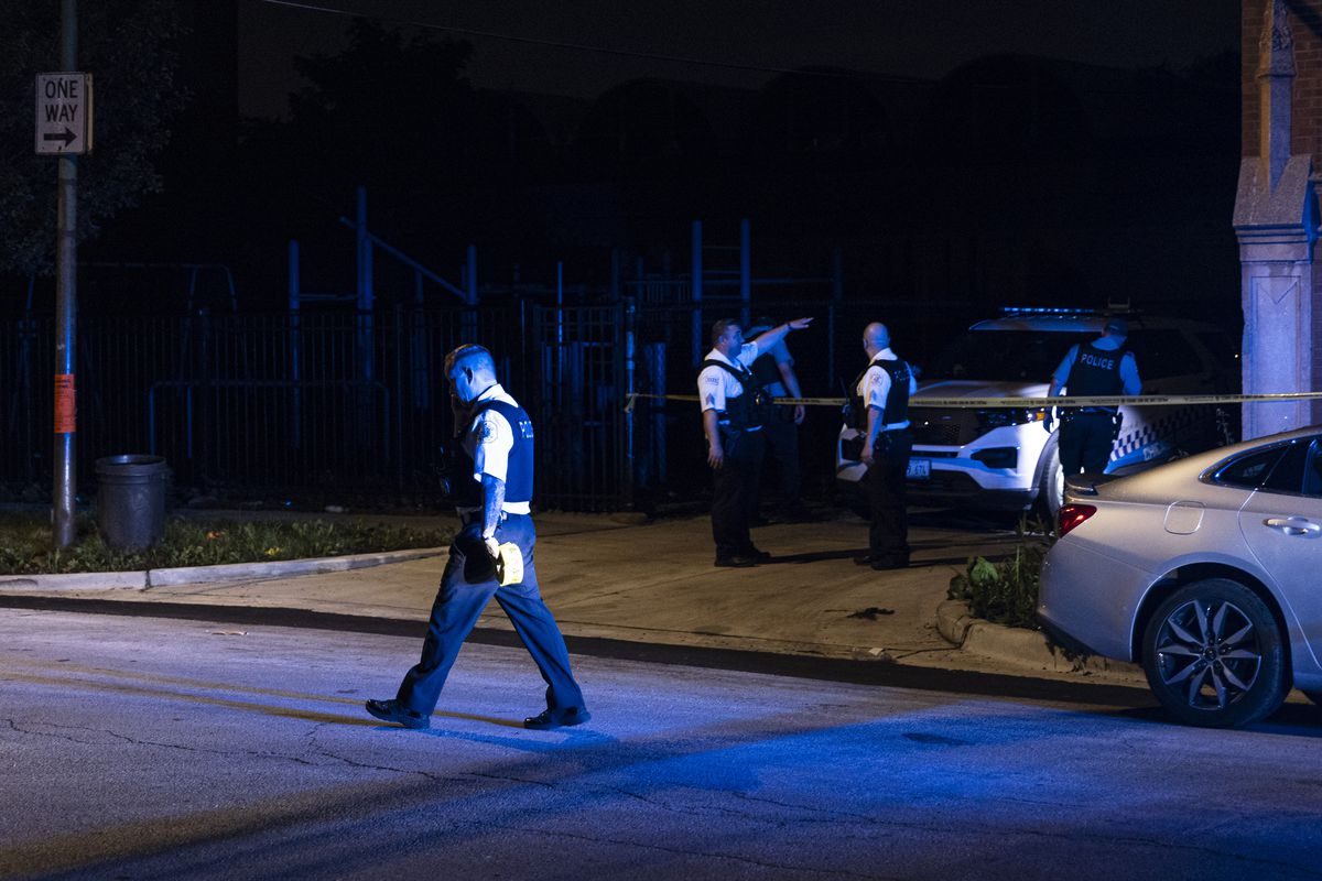 Police investigate the scene where at least four people were shot near 2245 S Willard St in Little Village, Wednesday, June 30, 2021.
