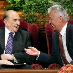 FILE - President Thomas S. Monson and President Dieter F. Uchtdorf share a laugh as they wait for the start of the Sunday afternoon session of the 183rd Semiannual General Conference for The Church of Jesus Christ of Latter-day Saints on Sunday, Oct. 6, 2013.