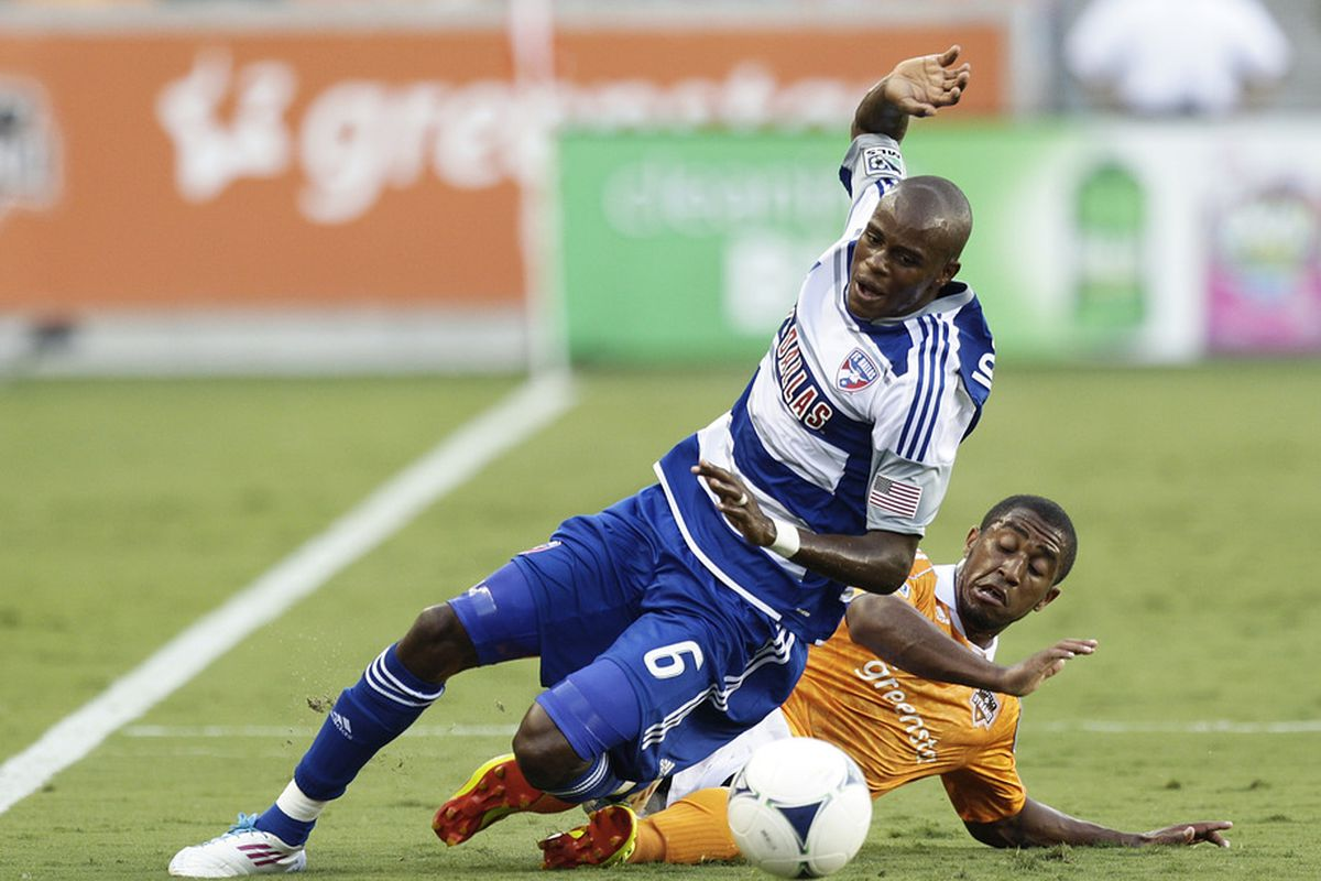 HOUSTON, TX - JUNE 16: Jackson #6 of the FC Dallas is taken down by Jermaine Taylor #4 of the Houston Dynamo in the first half at BBVA Compass Stadium on June 16, 2012 in Houston, Texas.  (Photo by Bob Levey/Getty Images)
