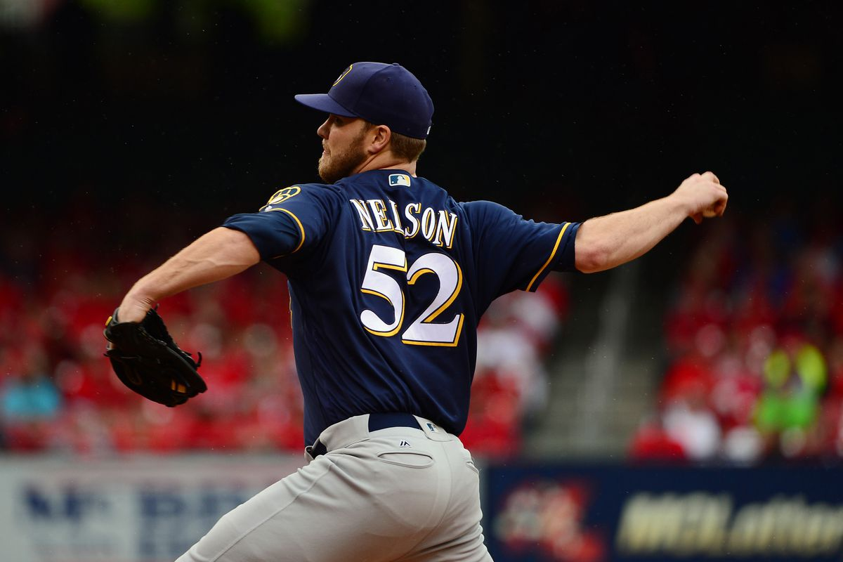Jimmy Nelson tries to shut down a potent Cards offense