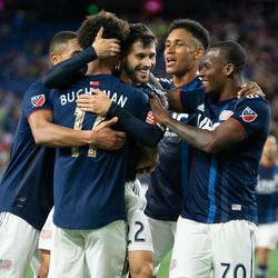 FOXBOROUGH, MA - MAY 11: New England Revolution midfielder Carles Gil #22 celebrates with his teammates after scoring in the second half at Gillette Stadium on May 11, 2019 in Foxborough, Massachusetts. (Photo by J. Alexander Dolan - The Bent Musket)