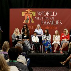 """Elder D. Todd Christofferson of the Quorum of the Twelve Apostles of The Church of Jesus Christ of Latter-day Saints presents """"Techniques for Family Unity from Mormon Homes"""" at the World Meeting of Families in Philadelphia on Thursday, Sept. 24, 2015. Elder Christofferson invited two LDS families to discuss how their families interact and to answer questions from the audience."""