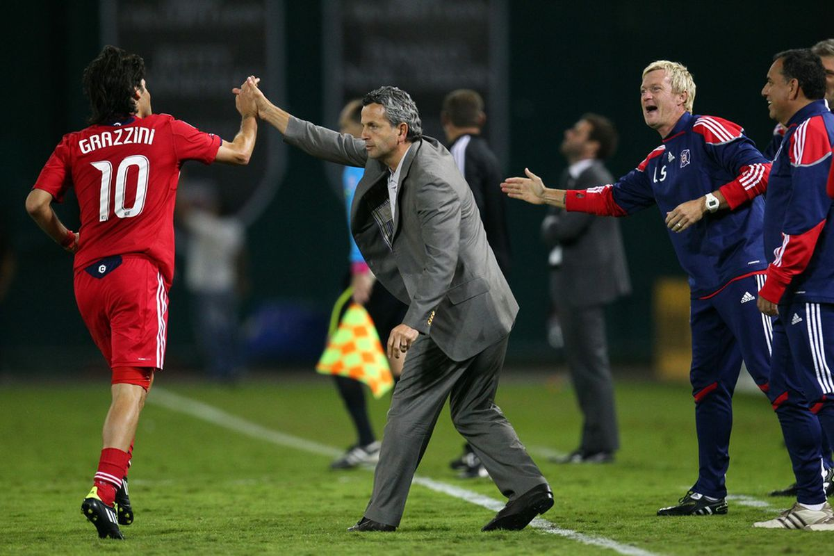 WASHINGTON, DC - OCTOBER 15: Head coach Frank Klopas and Sebastian Grazzini #10 of Chicago Fire celebrate after a goal against D.C. United at RFK Stadium on October 15, 2011 in Washington, DC. (Photo by Ned Dishman/Getty Images)