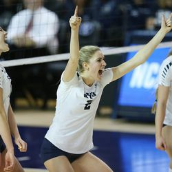 BYU's Cosy Burnett celebrates a point on American with teammates during the NCAA tournament in Provo on Friday, Dec. 1, 2017.