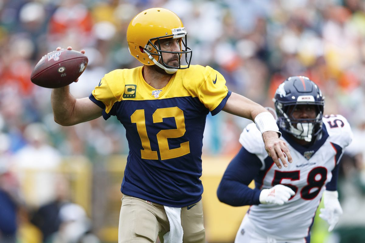 Green Bay Packers quarterback Aaron Rodgers throws a pass under pressure from Denver Broncos linebacker Von Miller during the second quarter at Lambeau Field.