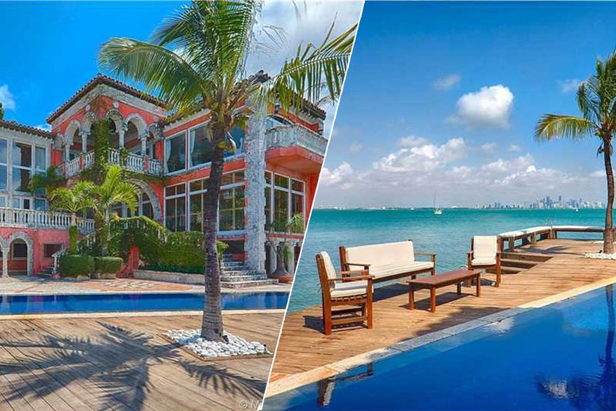 A bright red home on the water in key biscayne
