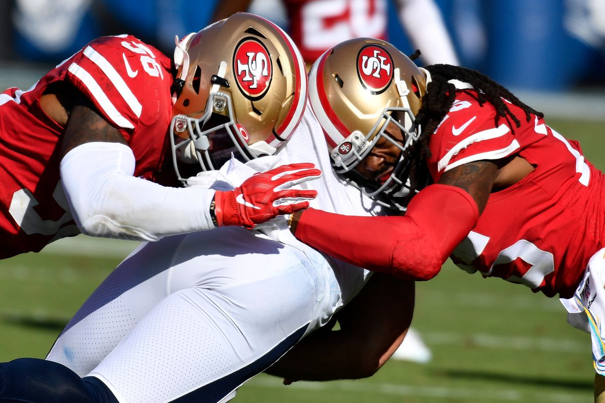 San Francisco 49ers middle linebacker Kwon Alexander and San Francisco 49ers cornerback Richard Sherman tackle Los Angeles Rams tight end Tyler Higbee during the fourth quarter at Los Angeles Memorial Coliseum.