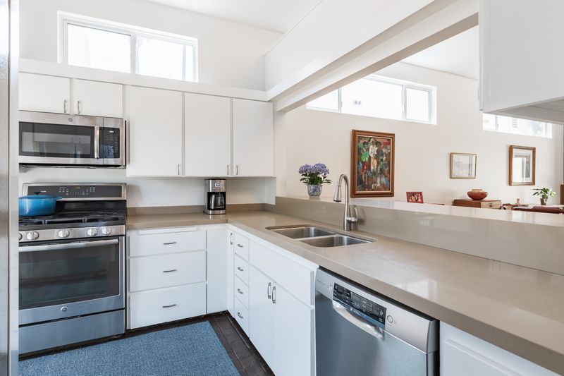Kitchen with white cabinets and stainless steel appliances.