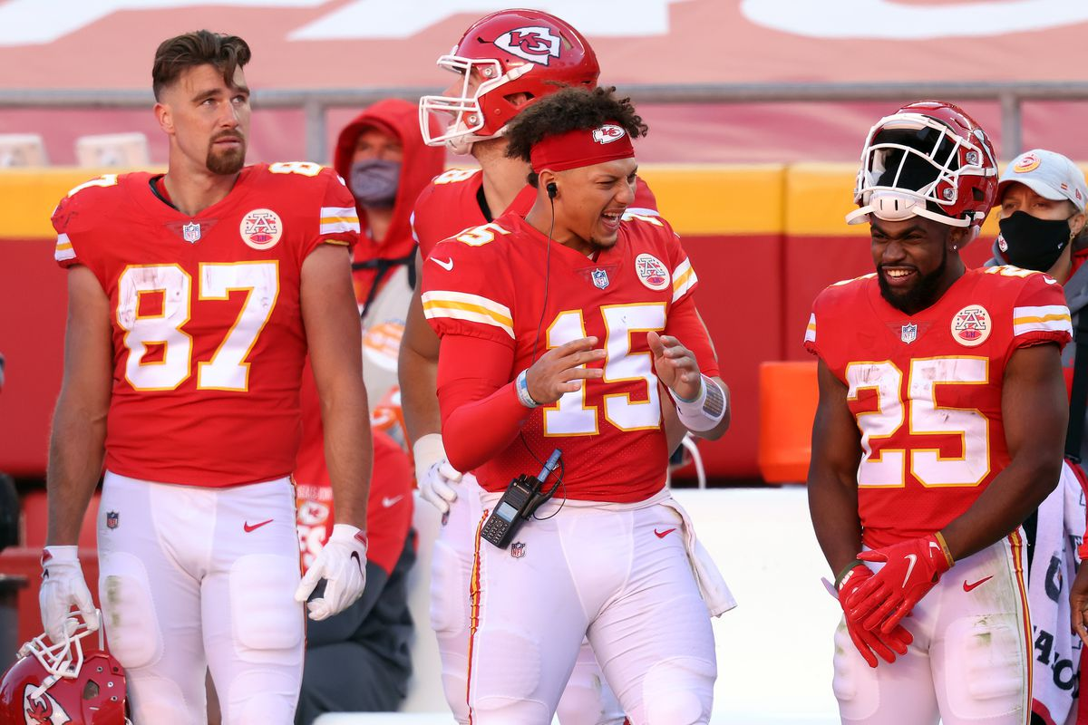 Patrick Mahomes #15 of the Kansas City Chiefs jokes with Clyde Edwards-Helaire #25 on the sidelines during their NFL game against the New York Jets at Arrowhead Stadium on November 01, 2020 in Kansas City, Missouri.