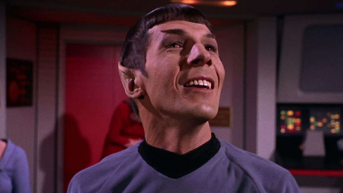 Leonard Nimoy as Spock, smiling and looking up in the original 1960s Star Trek series
