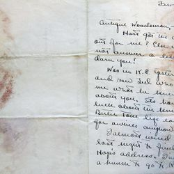 This Sept. 11, 2012, photo shows a letter sent to Ernest Hemingway from boyhood friend Carl Edgar around 1919, a part of the Hemingway collection at the John F. Kennedy Library and Museum, in Boston, that is being sent out for restoration. Among letters written to Ernest Hemingway slated for repair are dispatches from public figures including Hollywood stars Ingrid Bergman and Marlene Dietrich, writers F. Scott Fitzgerald and Gertrude Stein, and Hemingway's editor Max Perkins.