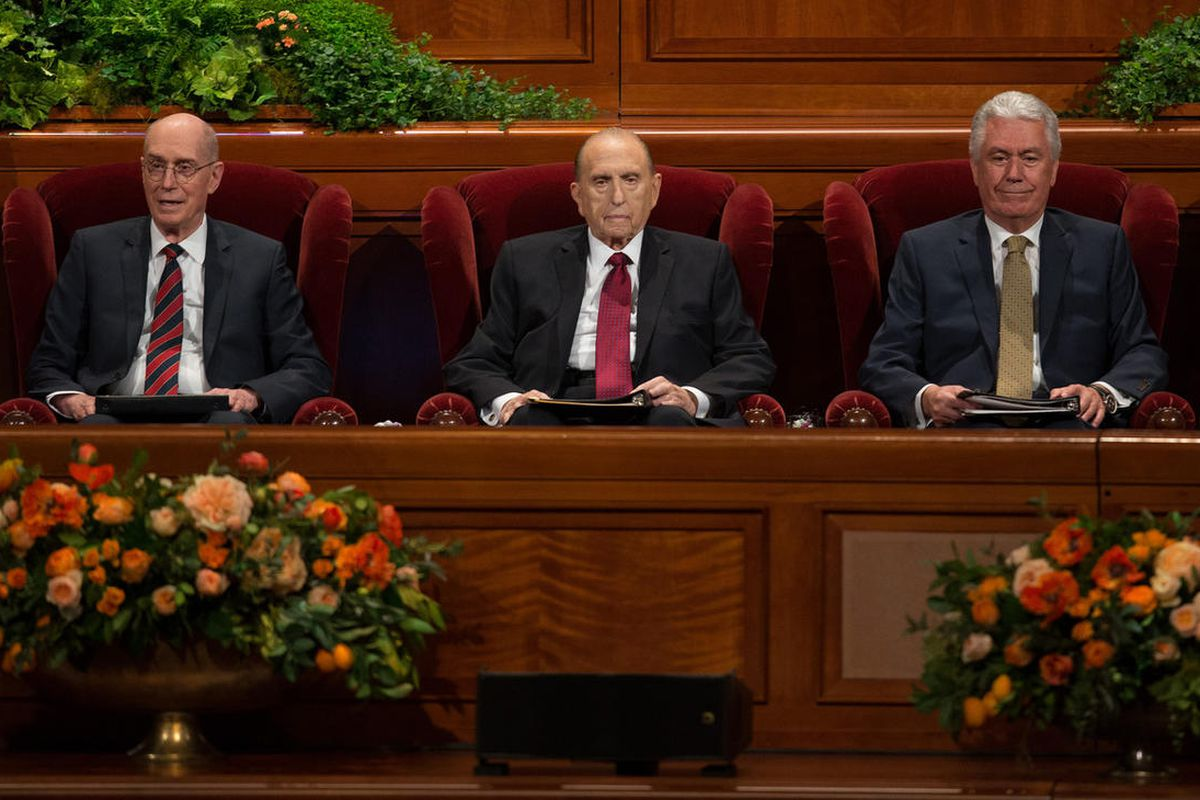 FILE - President Thomas S. Monson sits with his counselors President Henry B. Eyring First Counselor First Presidency and President Dieter F. Uchtdorf, Second Counselor in the First Presidency at the beginning of the Sunday morning session of the 186th Se