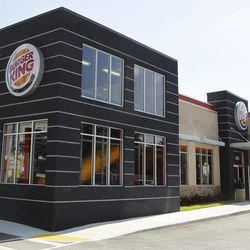 In this March 28, 2012 photo, a patron leaves a Burger King restaurant in Miami. On Monday, April 2, 2012, Burger King launches 10 menu items including smoothies, frappes, specialty salads and snack wraps in a star-studded TV ad campaign. It's the biggest menu expansion since the chain opened its doors in 1954.