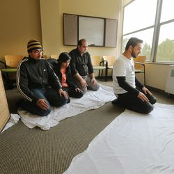 Muslim students at the University of Utah pray at the A. Ray Olpin Student Union on Monday, Nov. 16, 2015.