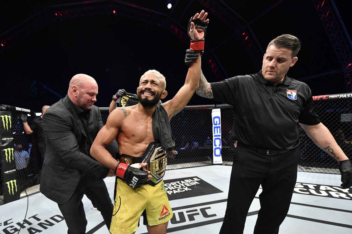 In this handout image provided by UFC, Deiveson Figueiredo of Brazil celebrates after defeating Joseph Benavidez in their UFC flyweight championship bout during the UFC Fight Night event inside Flash Forum on UFC Fight Island on July 19, 2020 in Yas Island, Abu Dhabi, United Arab Emirates.