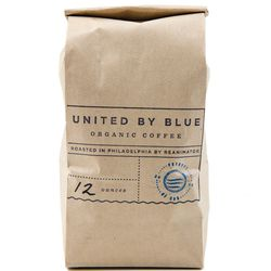 """Coffee roasted by Fishtown's ReAnimator Coffee Roaster has a home at the Old City boutique United By Blue. [12-oz bag of coffee, <a href=""""http://unitedbyblue.com/collections/home/products/12-oz-organic-coffee"""">$14</a>]"""