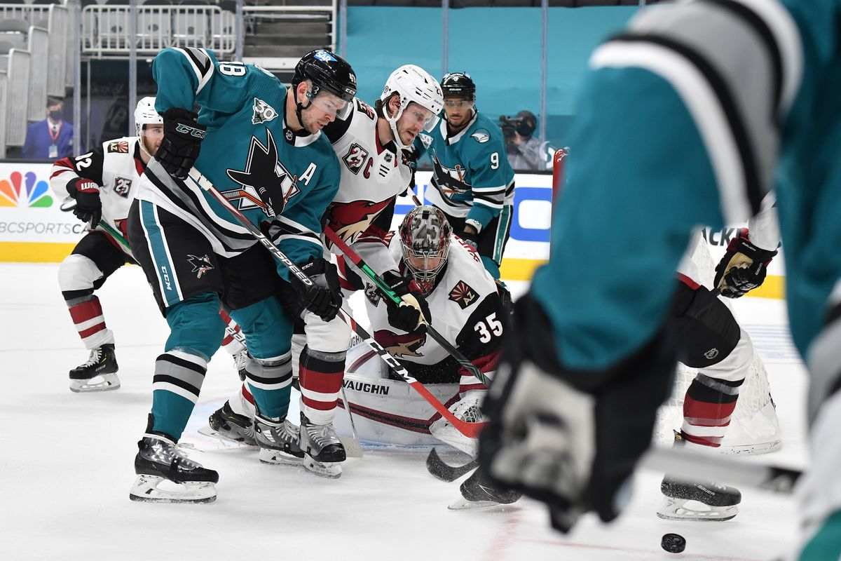 Tomas Hertl #48 of the San Jose Sharks fights for the puck against the Arizona Coyotes at SAP Center on May 7, 2021 in San Jose, California.