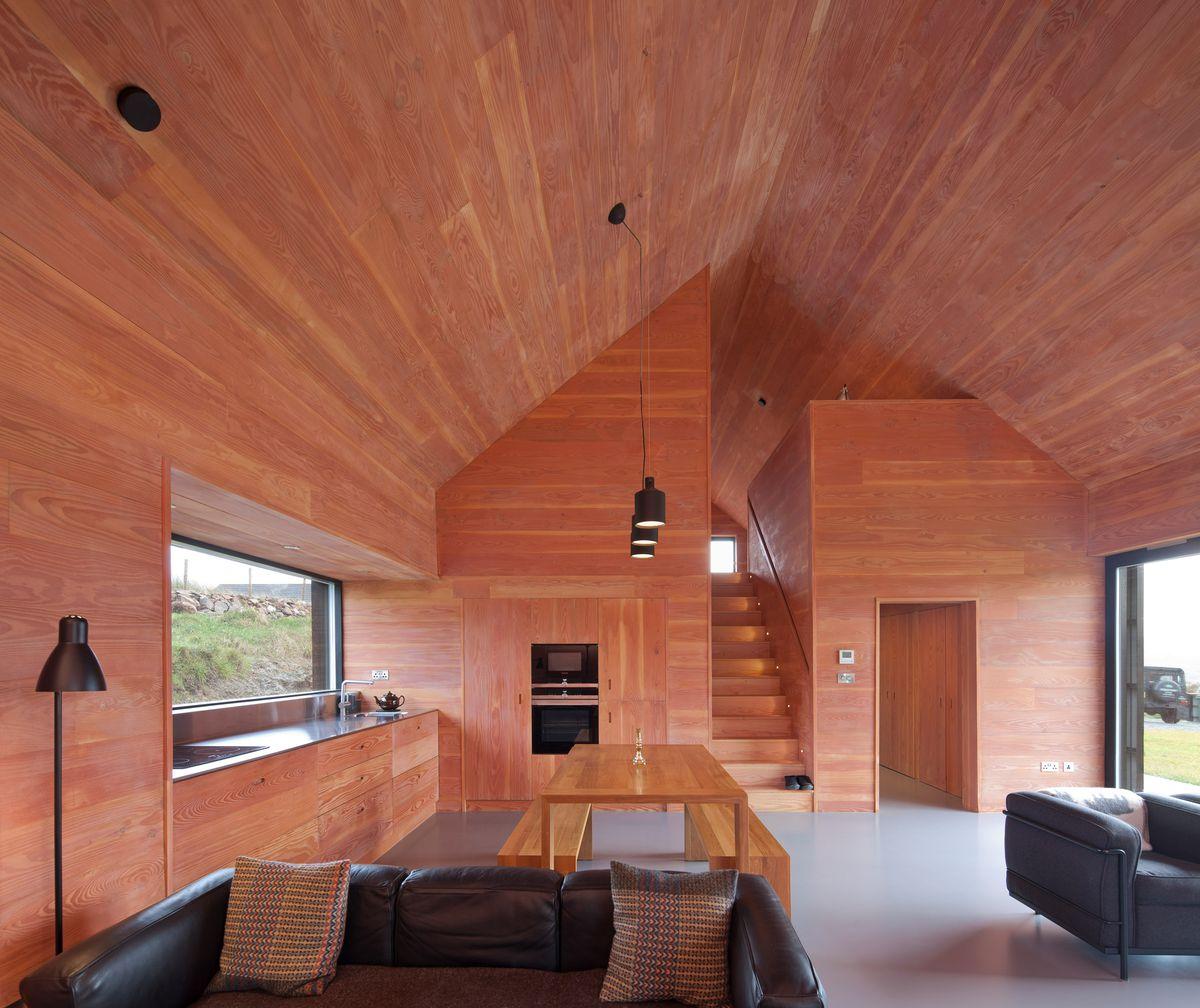 Warm wood interior with black furniture
