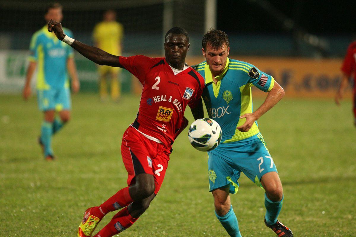 Alex Caskey fights off a Caledonia defender (Photo courtesy of SoundersFC.com)