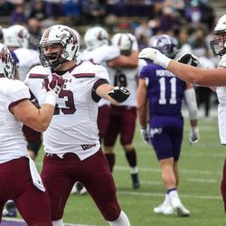 The Southern Illinois Salukis celebrate at Stewart Stadium in Ogden on Saturday, April 24, 2021.