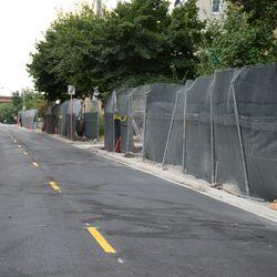 Mon 4:54 p.m. Work fences still up along the Waveland Avenue curb -
