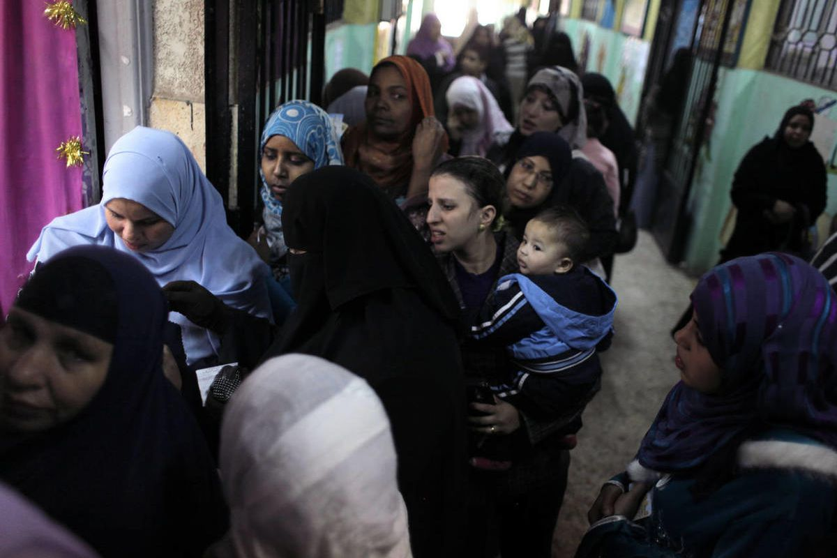 Egyptian women line up to vote at a polling center during the second day of the third round of the elections for Egypt's parliament, in Qalyobeia, Egypt, Wednesday, Jan. 4, 2012.