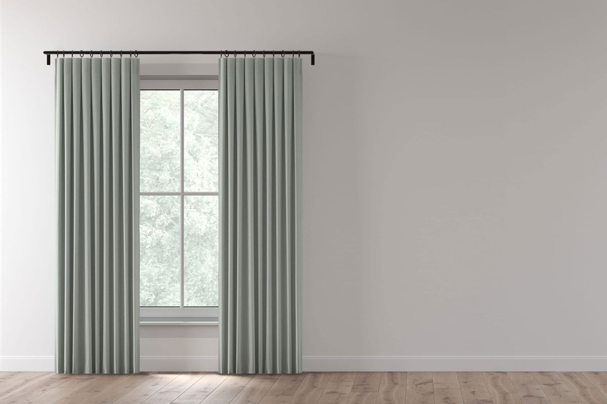 Window with double gray curtains.