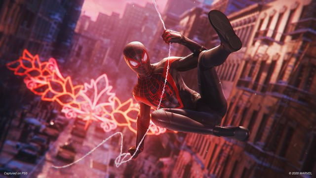 Spider-Man swinging through the streets in Spider-Man: Miles Morales