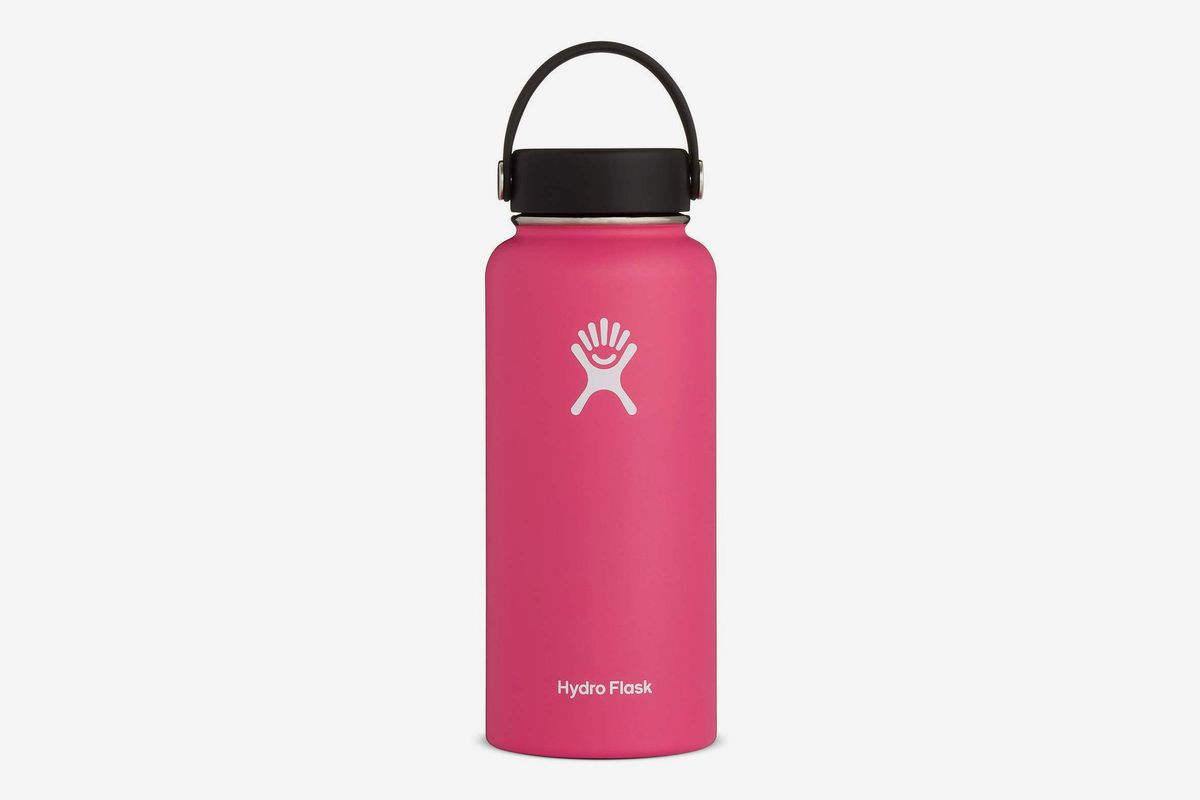 Pink water bottle with black cap.