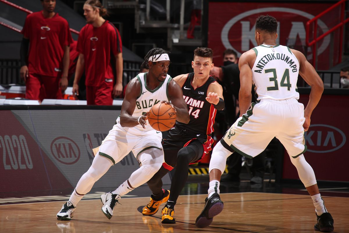 Jrue Holiday of the Milwaukee Bucks handles the ball against the Miami Heat on December 29, 2020 at American Airlines Arena in Miami, Florida.