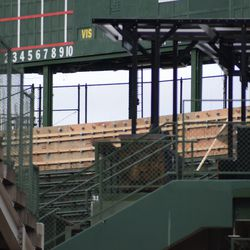 11:51 a.m. View of the work taking place in the center field bleachers, under the scoreboard -