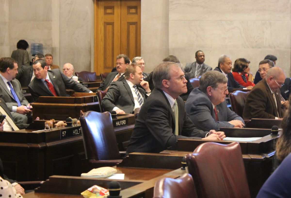 State Rep. Bill Dunn (center) looks straight ahead after tabling his voucher bill in 2016.