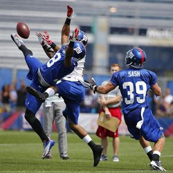 New York Giants cornerback Trumaine McBride (38) breaks up pass intended for wide receiver Brandon Collins (behind) as safety Tyler Sash (39) comes over to cover during training camp at the Timex Performance Center. [Jim O'Connor - USA Today Sports]