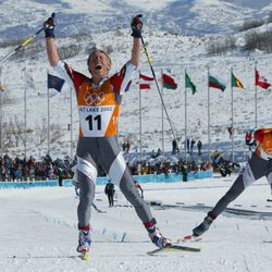 Austria's Christian Hoffmann celebrates finishing second and winning the silver medal as teammate Mikhail Botvinov wins the bronze during the men's 30K Olympic cross-country race at Soldier Hollow on Feb. 9, 2002.