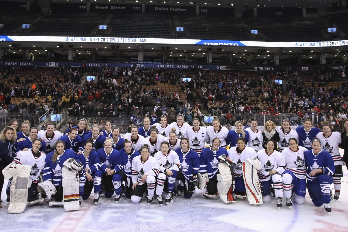 CWHL All-Stars and their coaches at centre ice