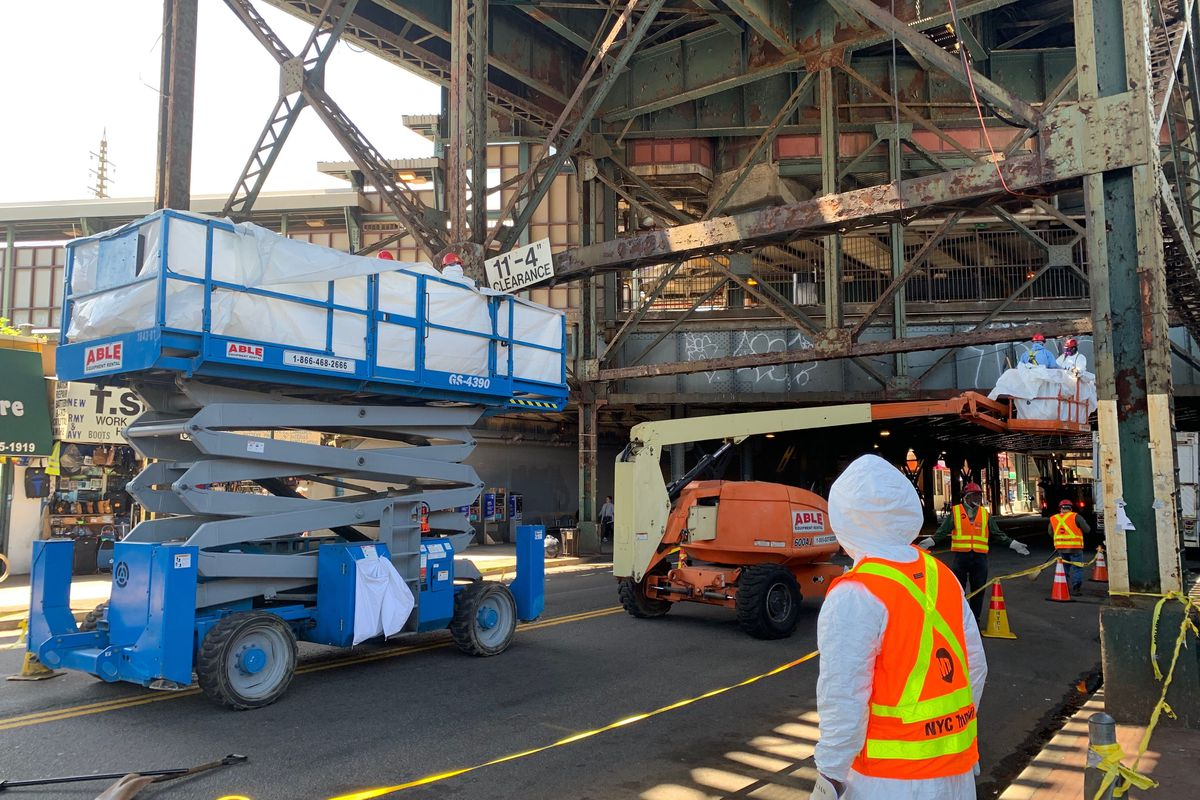 Transit workers inspect the elevated 7 train structure near the 61st Street-Woodside stop.