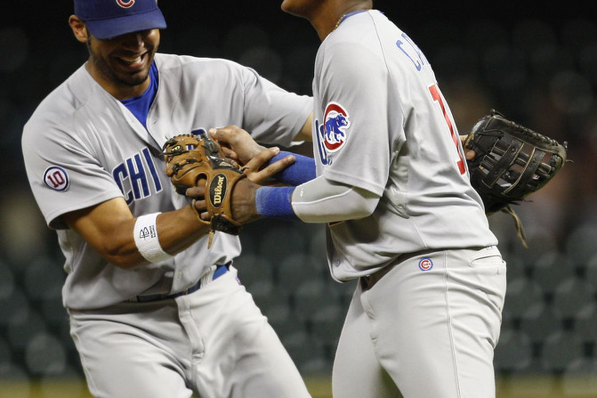 First baseman Carlos Pena of the Chicago Cubs celebrates with shortstop Starlin Castro their 4-3 victory over the Houston Astros at Minute Maid Park in Houston, Texas. (Photo by Eric Christian Smith/Getty Images)
